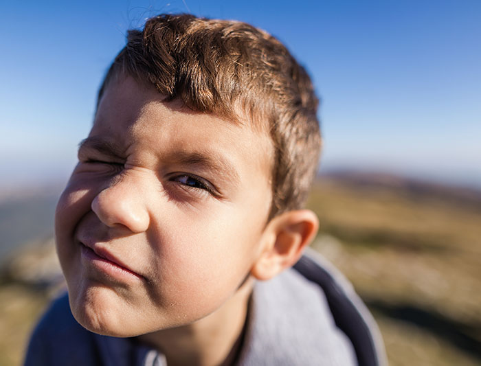 Cute 6 year old boy making silly face stock photo